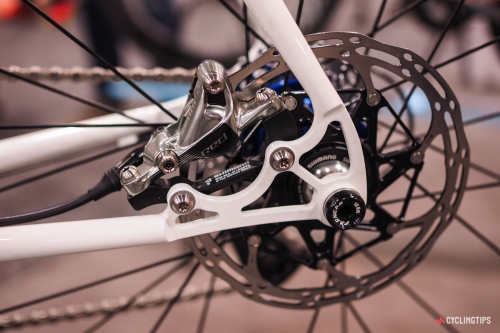 The steel thru-axle disc dropouts are graceful and delicate-looking.